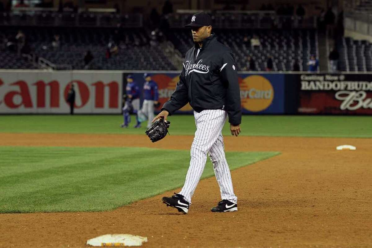 NEW YORK - OCTOBER 19: Mariano Rivera #42 of of the New York Yankees walks dejected from the bullpen back to the dugout after the Yankees lost 10-3 against the Texas Rangers in Game Four of the ALCS during the 2010 MLB Playoffs at Yankee Stadium on October 19, 2010 in the Bronx borough of New York City. (Photo by Jim McIsaac/Getty Images) *** Local Caption *** Mariano Rivera