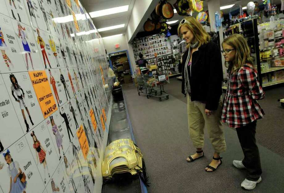 Nine-year-old Rebecca Diller and her mother, Amanda Diller, look over Halloween costume selections at the Party Warehouse in Clifton Park. (Michael P. Farrell / Times Union) Photo: Michael P. Farrell