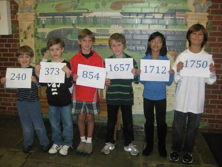 Students at Mill Hill Elementary School participated in its first-ever read-a-thon in October. Pictured are the winners of the most read minutes from each grade, in order (from left), kindergarten to fifth grade: Ryder Gatenby, Alexander McKinnis, David Burton, Patrick Kelly, Caitlin Chen and Crawford Mitchell. The students are holding up the minutes they read. Photo: Contributed Photo / Fairfield Citizen contributed