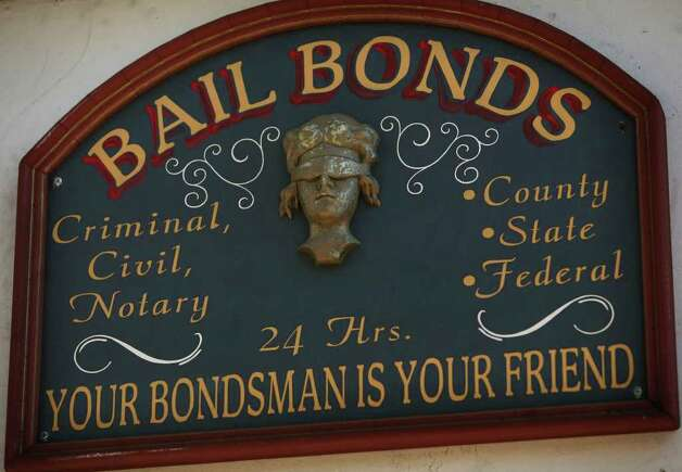A sign outside Aces Bail Bonds, across the street from the North Avenue jail at 1125 North Avenue in Bridgeport. Photo: Brian A. Pounds / Connecticut Post