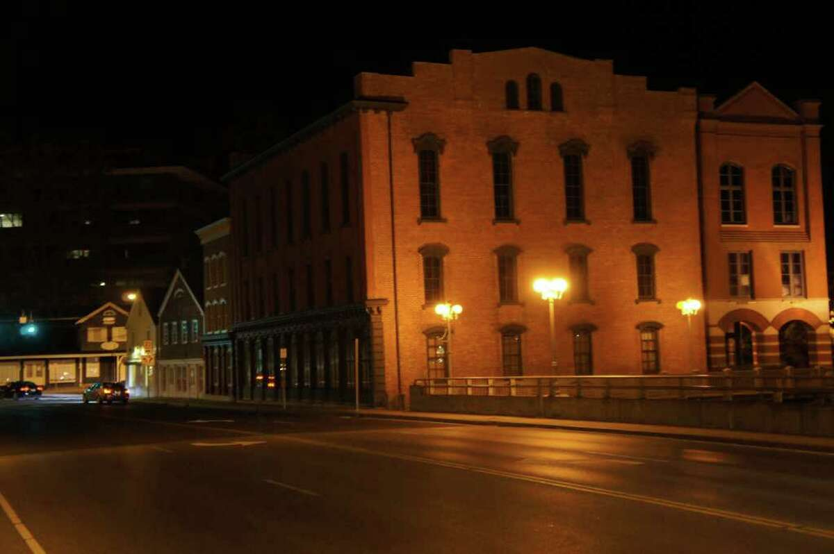 Cars drive past a vacant National Hall in downtown Westport at approximately 9 p.m. on Saturday, Oct. 2, 2010.
