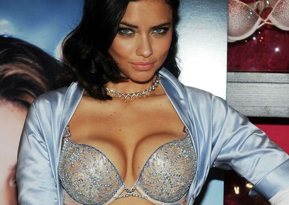 NEW YORK - OCTOBER 20:  Supermodel Adriana Lima reveals the $2 million bombshell fantasy bra designed by Damiani exclusively for Victoria's Secret at Victoria's Secret, SoHo on October 20, 2010 in New York City.  (Photo by Slaven Vlasic/Getty Images) *** Local Caption *** Adriana Lima Photo: Slaven Vlasic, Getty Images / 2010 Getty Images