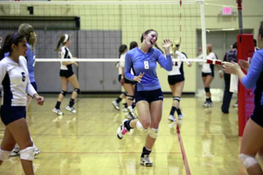 Johnson's Hannah Hornsby celebrates her team's lead as she heads toward the bench during a timeout.