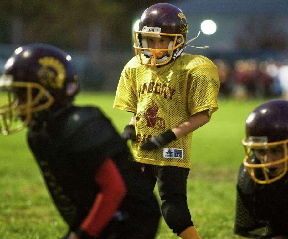 Nine year old Christina Syryla is a member of the Danbury Trojans senior mighty mites football team. Tuesday, Oct. 19, 2010 Photo: Scott Mullin / The News-Times Freelance