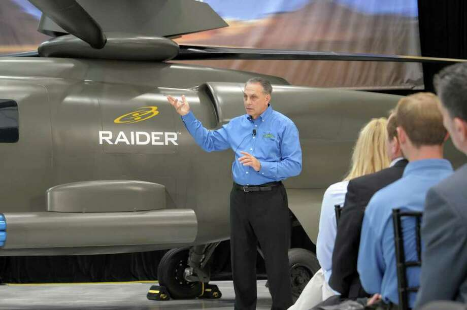 Jeffrey Pino, president of Sikorsky Aircraft, on Wednesday unveiled a mockup of its next major project, the S-97 Raider, a light tactical helicopter that uses a pusher prop at the rear for greater speed. Photo: Contributed Photo\C. David LaBianca / Connecticut Post Contributed\C. David LaBianca