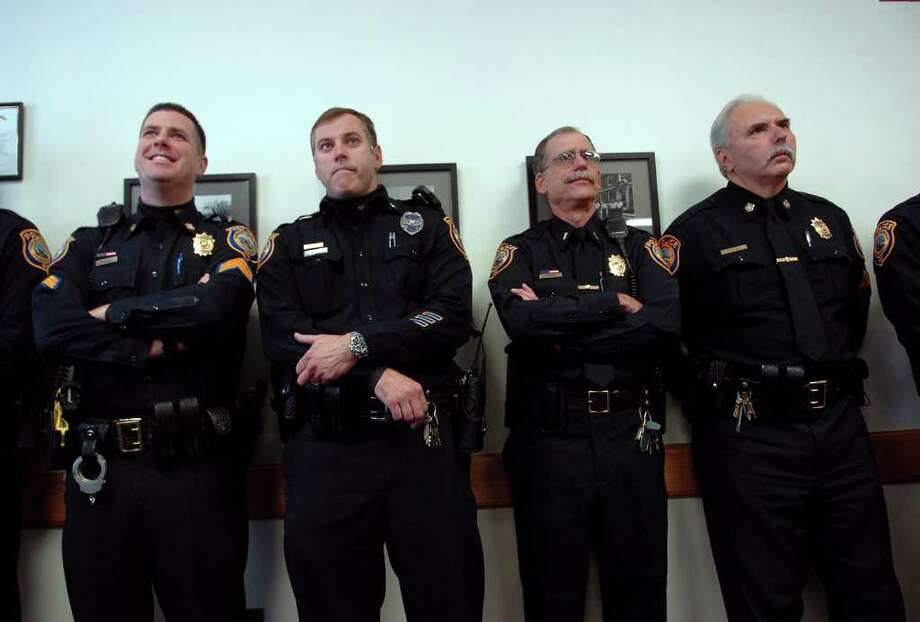 Fellow officers look as Fairfield native Ashley DelVecchio is sworn in as a Westport police officer at police headquarters in Westport, Conn. on Tuesday October 19, 2010. Photo: Christian Abraham / Connecticut Post