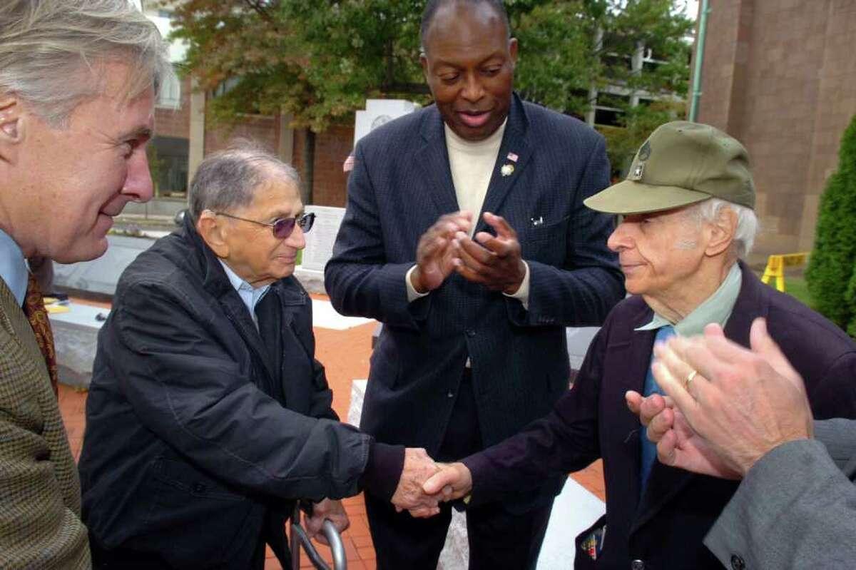 Harry Ruderman, a World War II veteran from Bridgeport shakes hands with Donald Dean, a Korean war veteran from Bridgeport Tuesday, Oct. 20th, 2010, after both men received overdue medals for their war service.