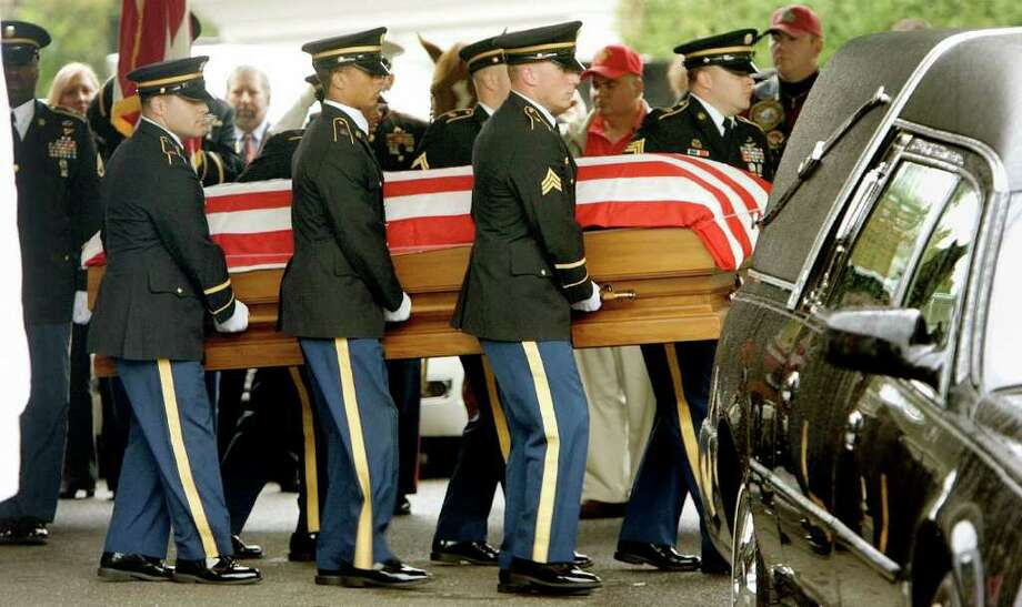 The body of United States Army Pfc. Gebrah Noonan is carried out of Albini Funeral Home in Waterbury, Conn., Tuesday morning Oct. 5, 2010 during funeral service. The Watertown, Conn. soldier died while serving in Iraq.  Millitary officials say Noonan was allegedly killed by a fellow soldier in Iraq. (AP Photo/The Republican-American, Steven Valenti) Photo: Steven Valenti, AP / © 2010 The Republican-American