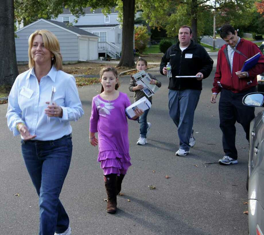 Brenda Kupchick, the Republican nominee for state representative in the 132nd District, leads her campaign team during an afternoon of door-to-door campaigning in the Tunxis Hill neighborhood of Fairfield on Saturday, Oct. 16, 2010. They are, from left, Kupchick, her niece Gianna, her niece Allie, and campaign volunteers Jon Crovo and Paul Pimentel. Photo: Paul Schott / Fairfield Citizen