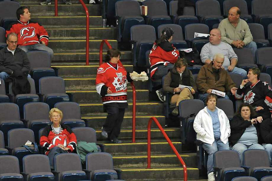 The crowd at Times Union Center for the Devils-Checkers game include people wear both River Rats and Devils jerseys. Photo: Lori Van Buren