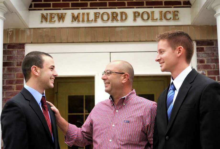 State Police Academy recruits Collin Marino, left, and Rayden Arnold, right, both 25, talk with New Milford police investigator Henry Marino at police headquarters on Thursday, Oct. 21, 2010. Henry is Collin's dad. Photo: Michael Duffy / The News-Times
