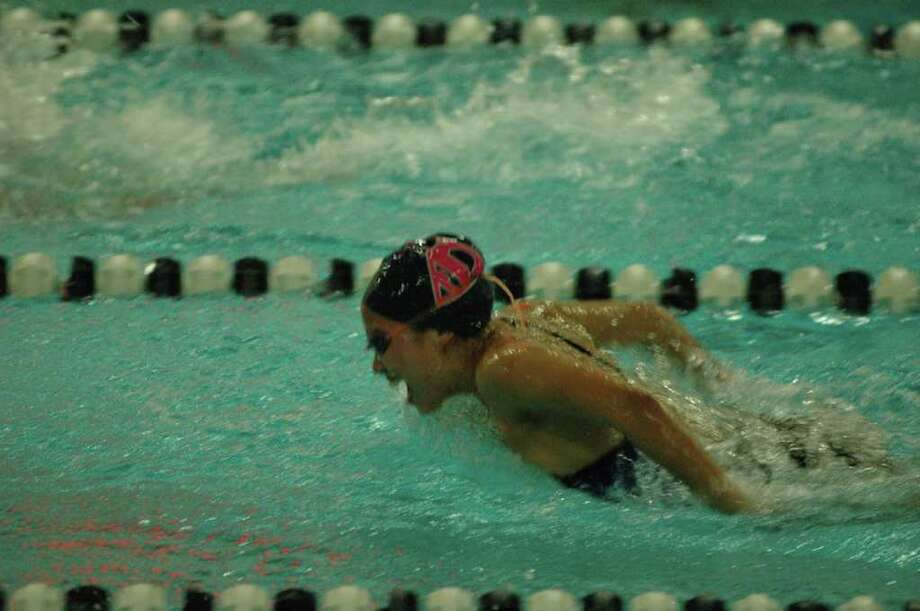 Staples junior Caroline Valerio placed third in the 100-meter butterfly on Wednesday in a 101-83 home loss to Greenwich. Photo: Contributed Photo / Ron Wimer