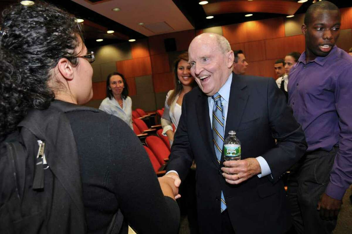 Jack Welch chats with Sacred Heart University sophomore Aitzarelys Negron, left, during his visit to campus on Wednesday. At right is SHU alumnus Taariq Cayne. Sacred Heart University photo by Tracy Deer-Mirek