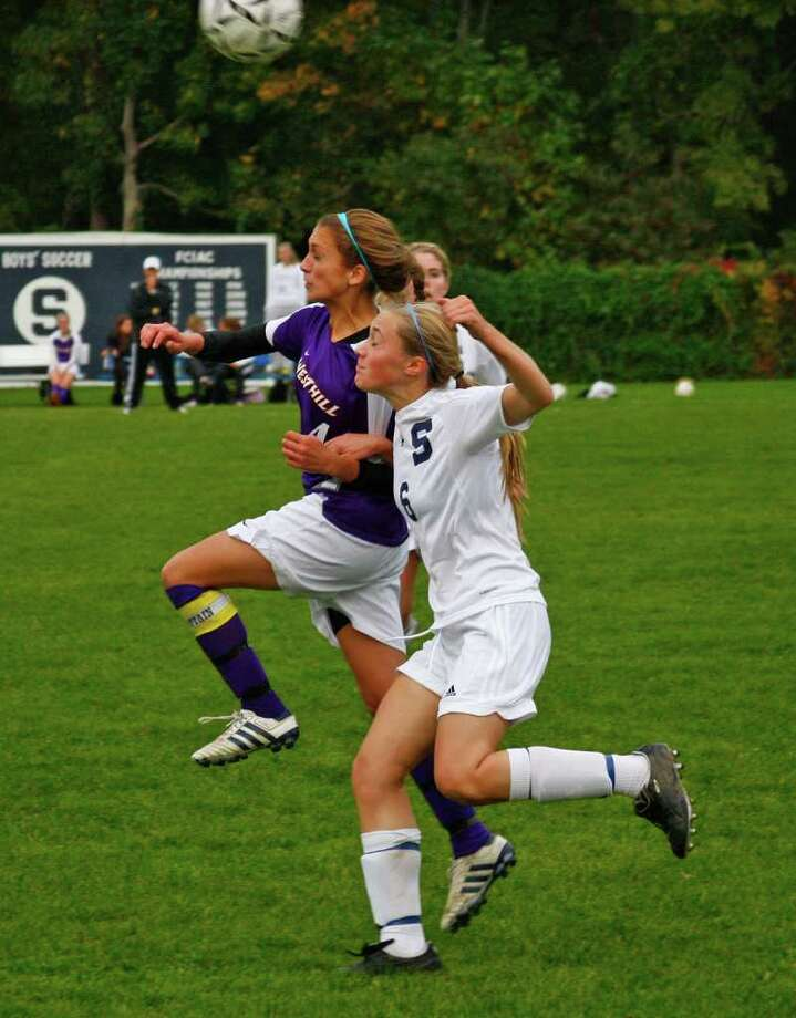 Soccer highlights between Staples against Westhill in Westport, Conn. on Wednesday October 20, 2010. Westhill's #4 Haley Hilsenrath and Staples #6 Turner Block, right. Photo: Christian Abraham / Connecticut Post