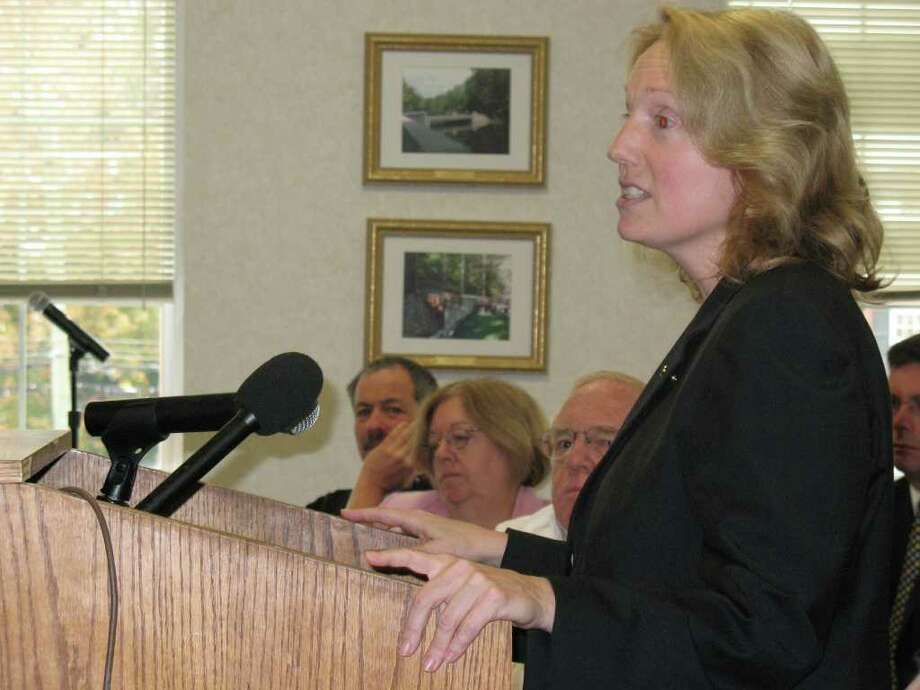 Greenwich resident Melissa Chamberlin speaks during the Board of Selectmen's meeting Thursday. The selectmen decided to put off a decision on a lease agreement with T-Mobile to place a cell tower in the Montgomery Pinetum. Instead, selectmen voted to hire a consultant to study the issue. Photo: Frank MacEachern, Contributed Photo / Frank MacEachern / Greenwich Time
