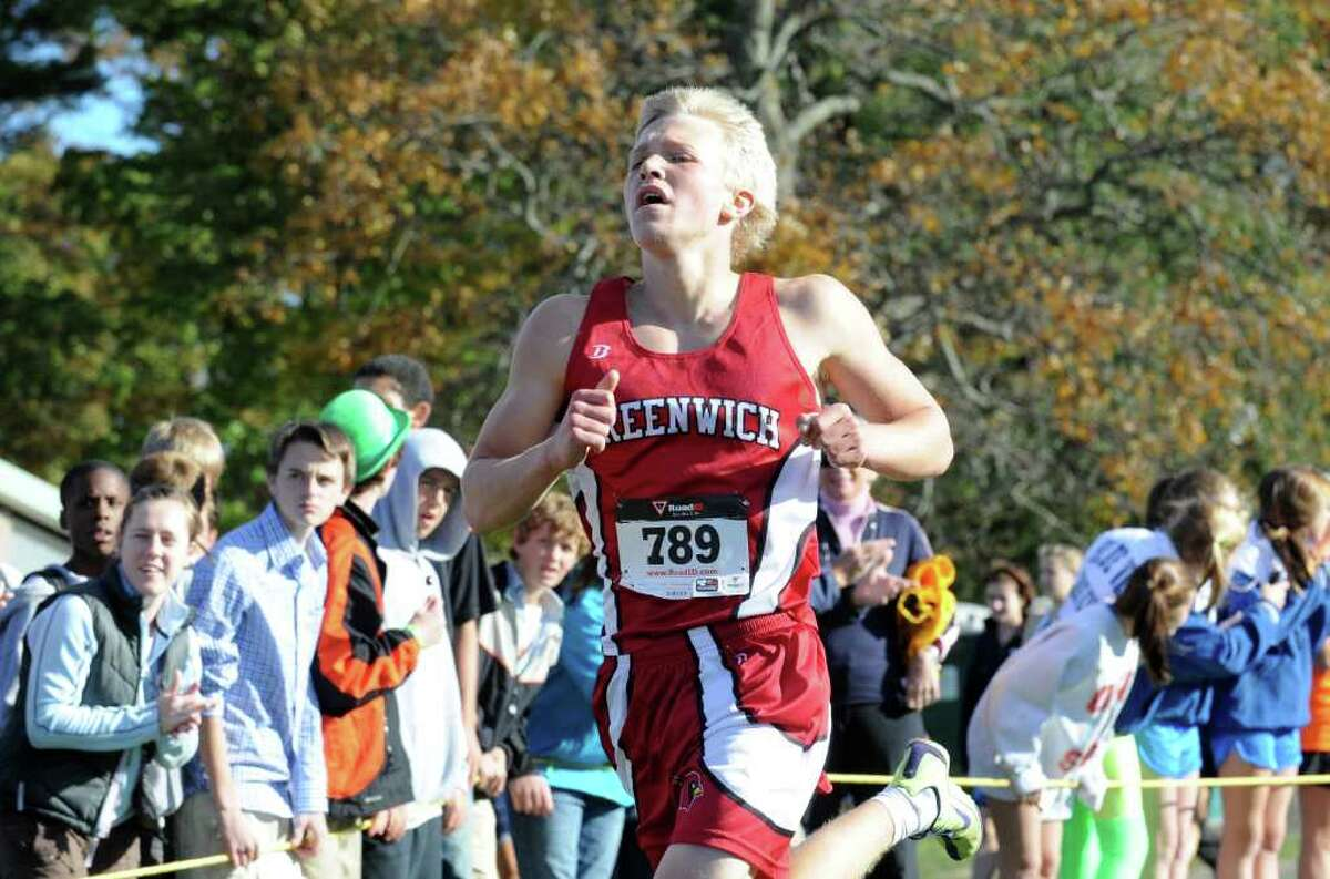 Greenwich's Victor Dahl races in the FCIAC Cross Coutry Championships at Waveny Park in New Canaan Thursday, October 21, 2010.