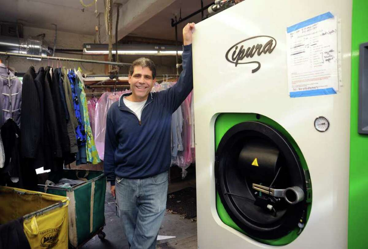 Steve Werner, of Bestever Cleaners, stands with his new eco-friendly machine, in Greenwich, Tuesday, Oct. 12, 2010.