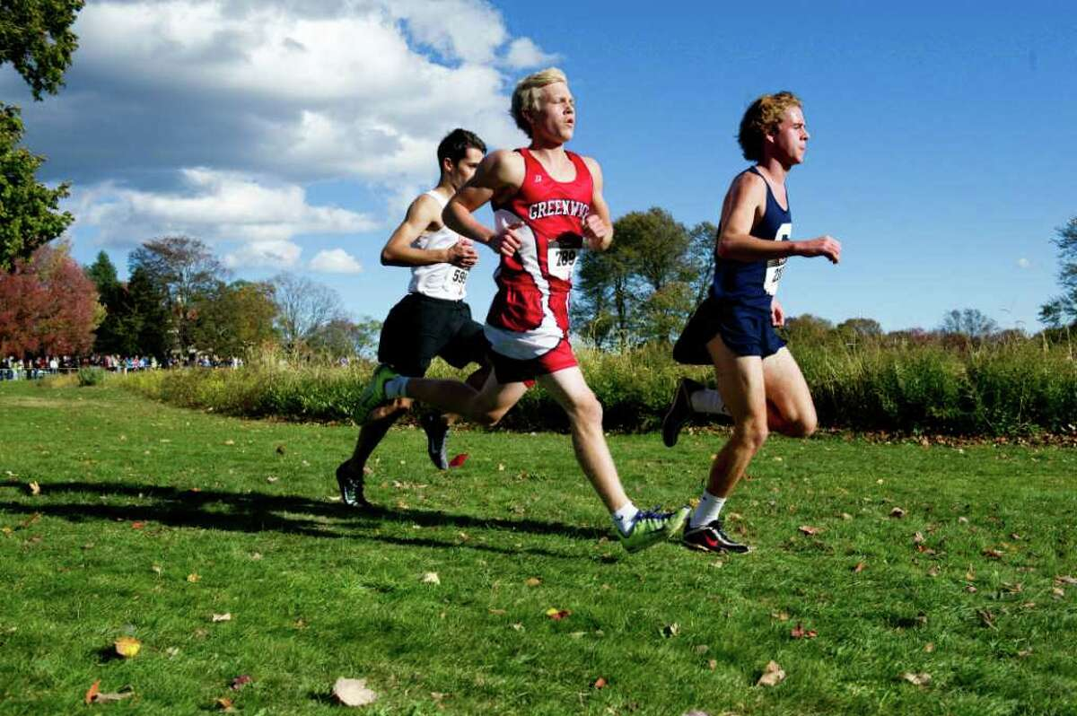 Staples' Ben Aldrich, Greenwich's Victor Dahl, center, and New Canaan's Alex Spinu race in the FCIAC Cross Coutry Championships at Waveny Park in New Canaan Thursday, October 21, 2010.