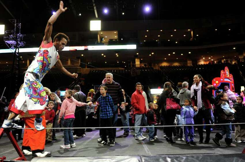 Visitors watch as a performer demonstrates tightrope-walking during the All Access Pre-Show to the Ringling Brothers and Barnum and Baily circus at the Arena at Harbor Yard on Thursday, October 21, 2010.