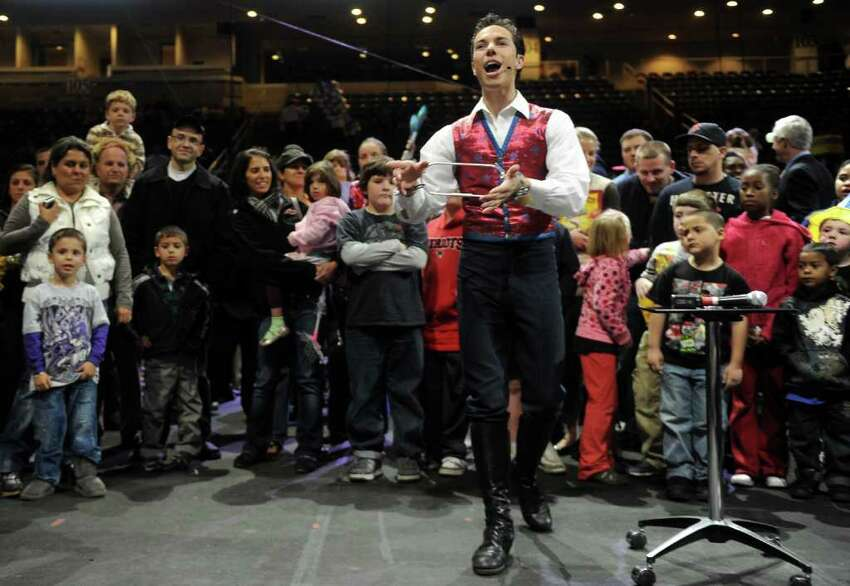 Alex Ramon performs an escape trick during the All Access Pre-Show to the Ringling Brothers and Barnum and Baily circus at the Arena at Harbor Yard on Thursday, October 21, 2010.