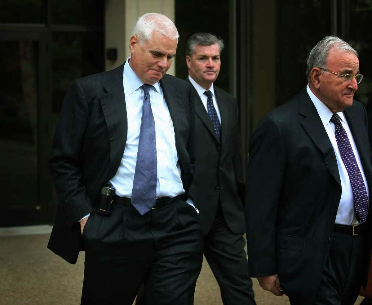 Accompanied by his lawyers, real estate developer Bob Scinto leaves the Federal Courthouse in Bridgeport on Thursday, October 21, 2010, after pleading guilty to making a false statement to FBI agents regarding gifts he provided to Shelton city officials.