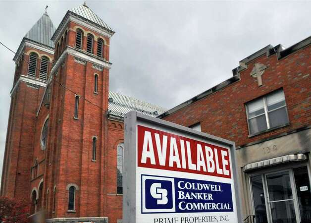 For sale sign outside the former St. Paul the Apostle church in Troy Thursday morning October21, 2010.  (John Carl D'Annibale / Times Union) Photo: John Carl D'Annibale / 00010703A
