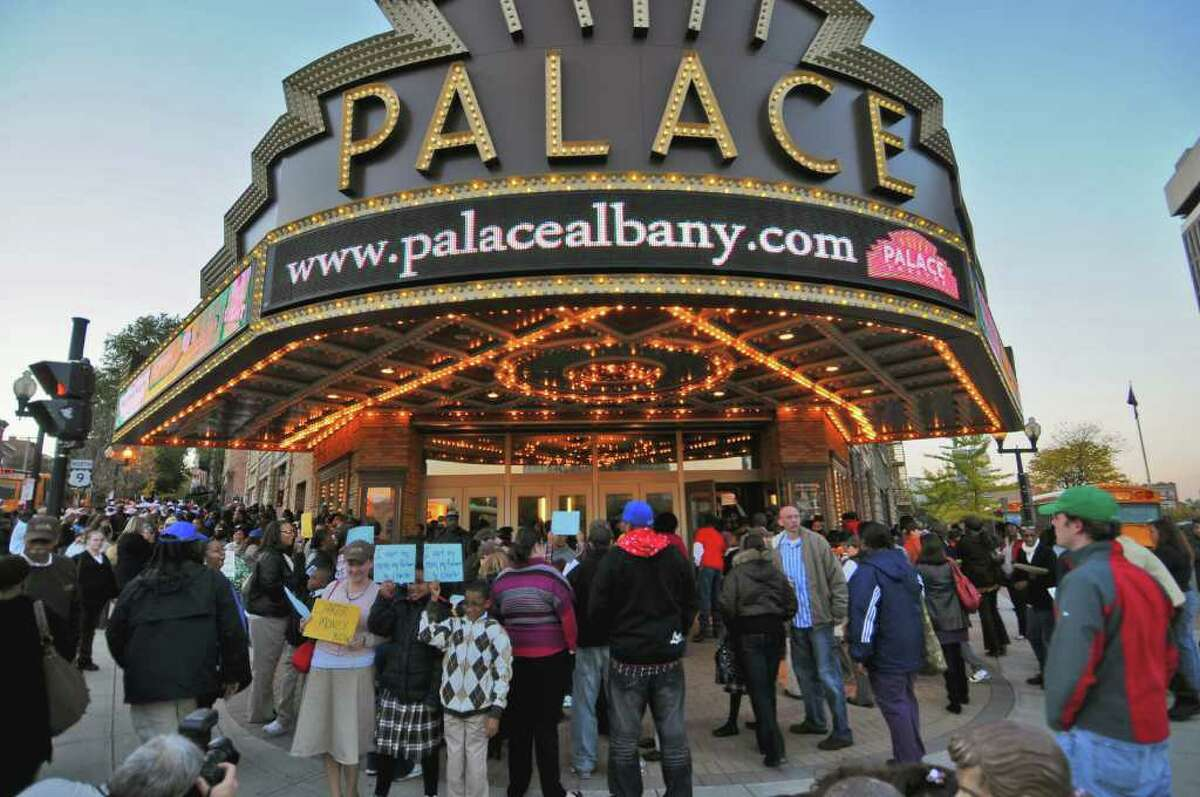 """The entrance to the Palace Theatre in Albany was a bustling spot Wednesday before a screening of the film """"Waiting for Superman."""" (Philip Kamrass / Times Union)"""