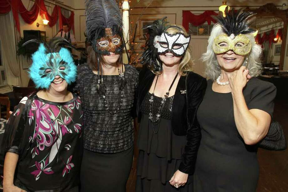 From left, Eileen Scheier, Michelle Chank, Peggy Kennedy and Nancy Kendall show off their masks. (Joe Putrock / Special to the Times Union) Photo: Joe Putrock / Joe Putrock