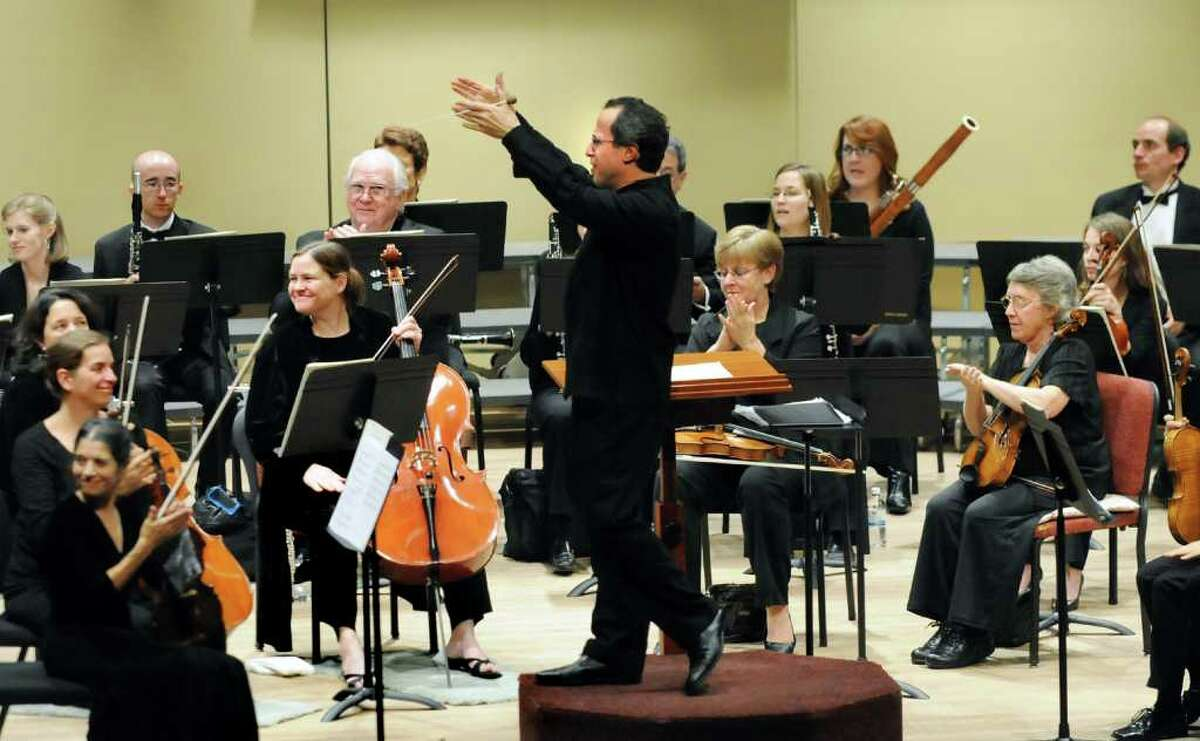 Albany Symphony Orchestra conductor David Miller, center, salutes actors from the Capital Repertory Theatre when they perform William Shakespeare's