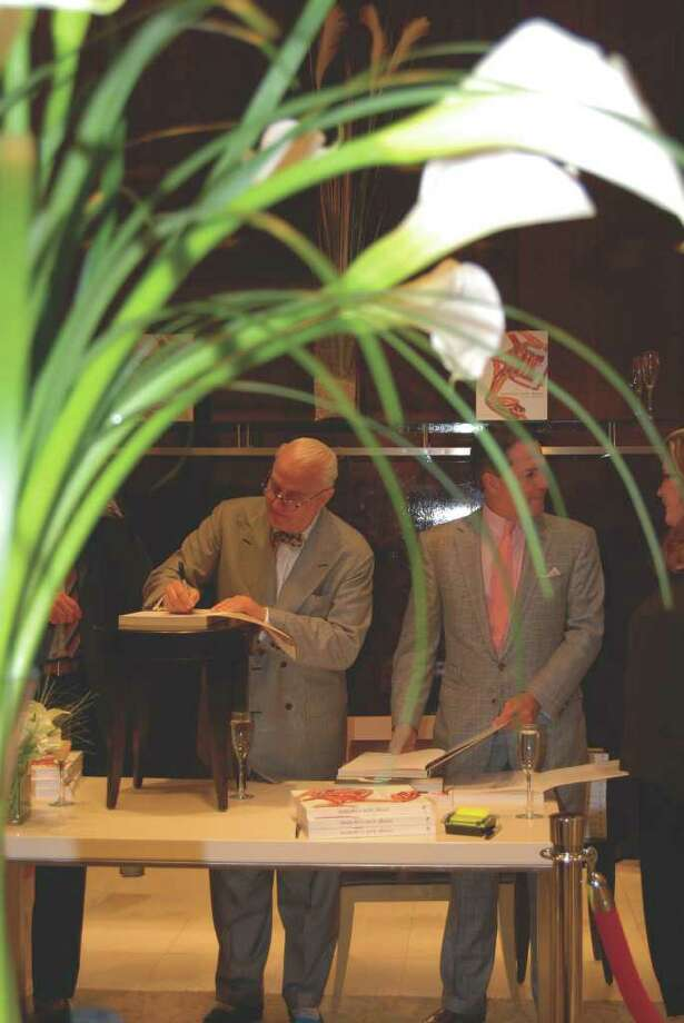 Manolo Blahnik signs his latest book for a fan at Richards of Greenwich last Wednesday. Photo: Jeanna Petersen Shepard / New Canaan News
