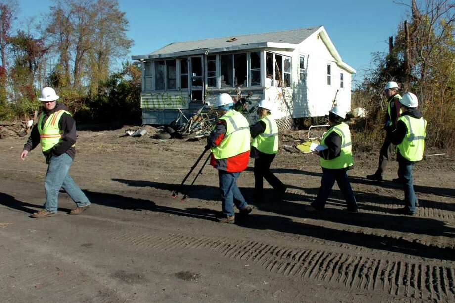 Members of the media take a tour of Long Beach West in Stratford, Conn. Friday, Oct. 22nd, 2010, where cottages are being demolished. Photo: Ned Gerard / Connecticut Post
