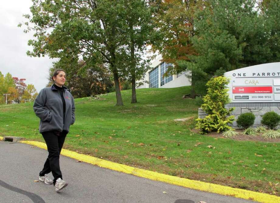 JoAnn Jensen, of Danbury, who works near many of Scinto's Shelton buildings in Enterprise Corporate Park, takes a stroll around the park during her lunch break. Jensen was shocked  by the news of robert Scinto's guilty plea. Photo: Tim Loh / Connecticut Post