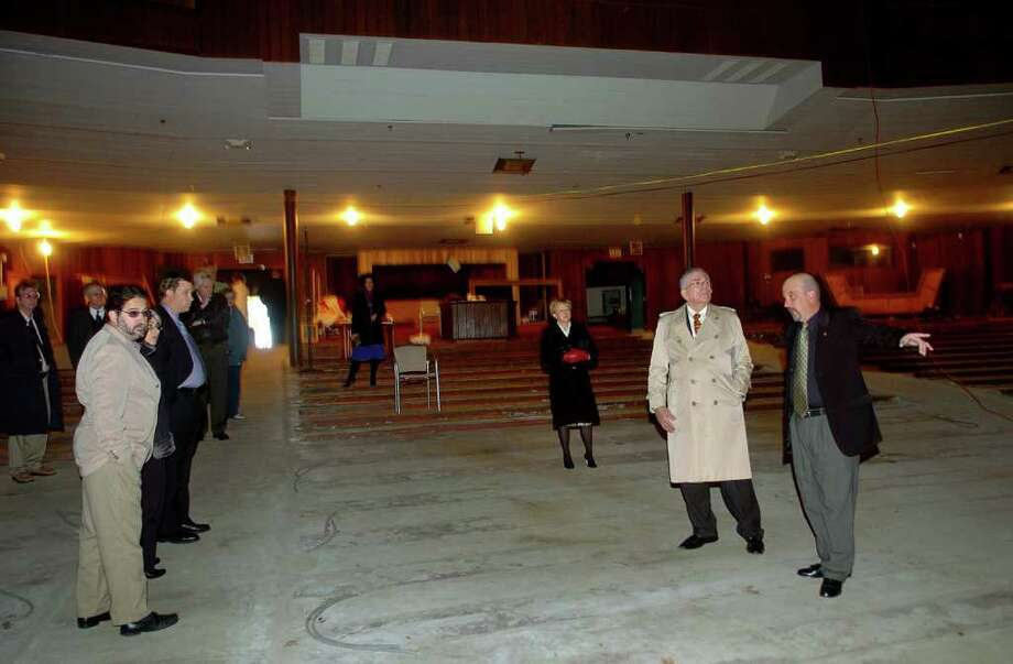Stratford Councilman Matt Catalano, at right, gives a quick inside tour of the Shakespeare Theater in Stratford, Conn. on Friday October 22, 2010. To Matt's left is Lou Galie, Senior Vice President of Technology at Timex. Galie was on hand to unveil a new sundial made at Timex for the theater, to replace the original one they made. Photo: Christian Abraham / Connecticut Post