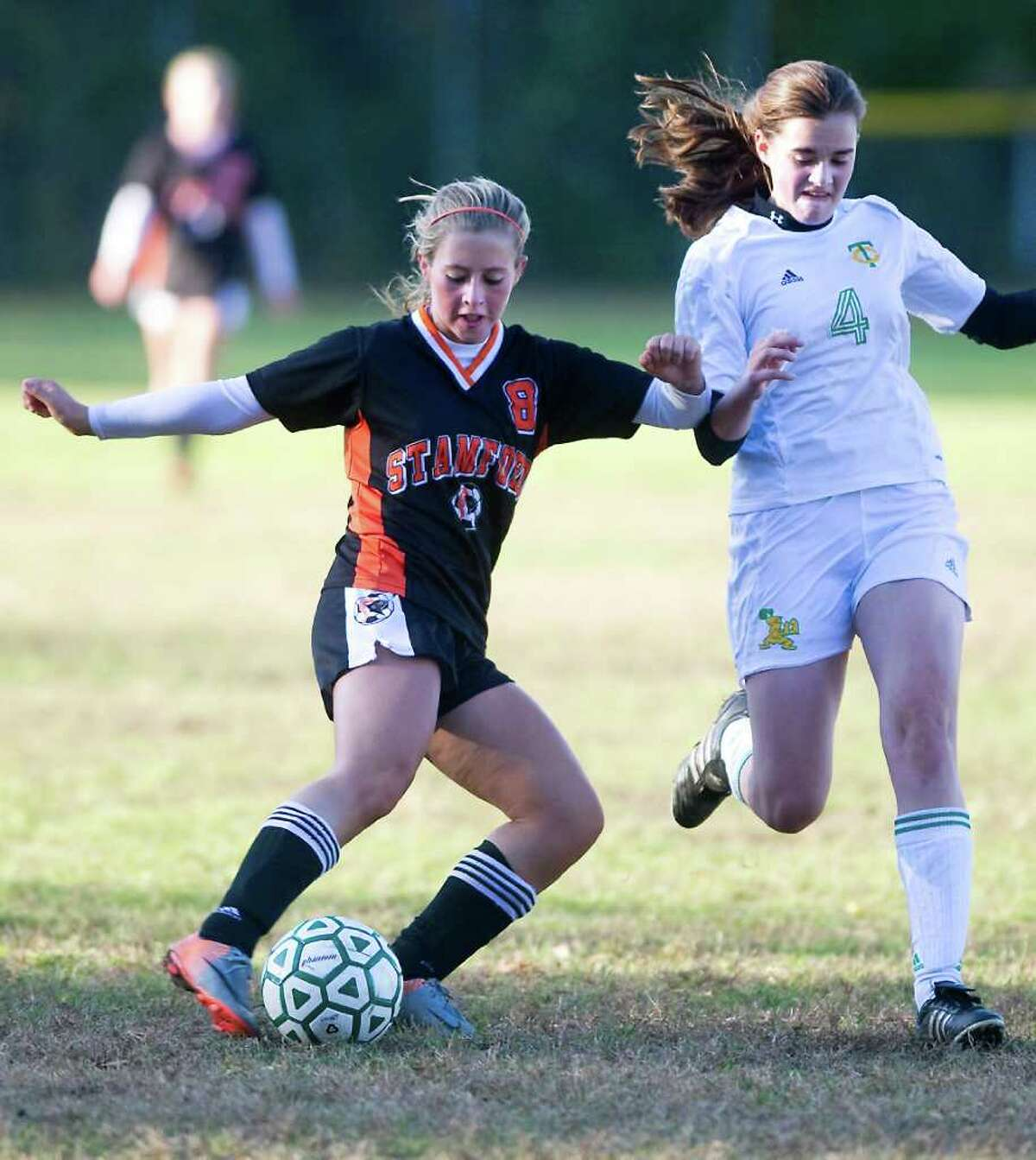 Stamford High School's Kaela Schneider controls the ball against Trinity Catholic High School's Kathryn Connolly in girls soccer at Trinity in Stamford, Conn. on Friday October 22, 2010. Stamford won 4-1.