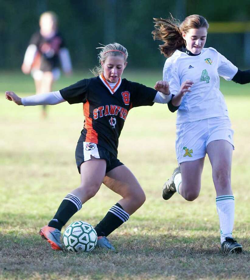 Stamford High School's Kaela Schneider controls the ball against Trinity Catholic High School's Kathryn Connolly in girls soccer at Trinity in Stamford, Conn. on Friday October 22, 2010.  Stamford won 4-1. Photo: Kathleen O'Rourke / Stamford Advocate