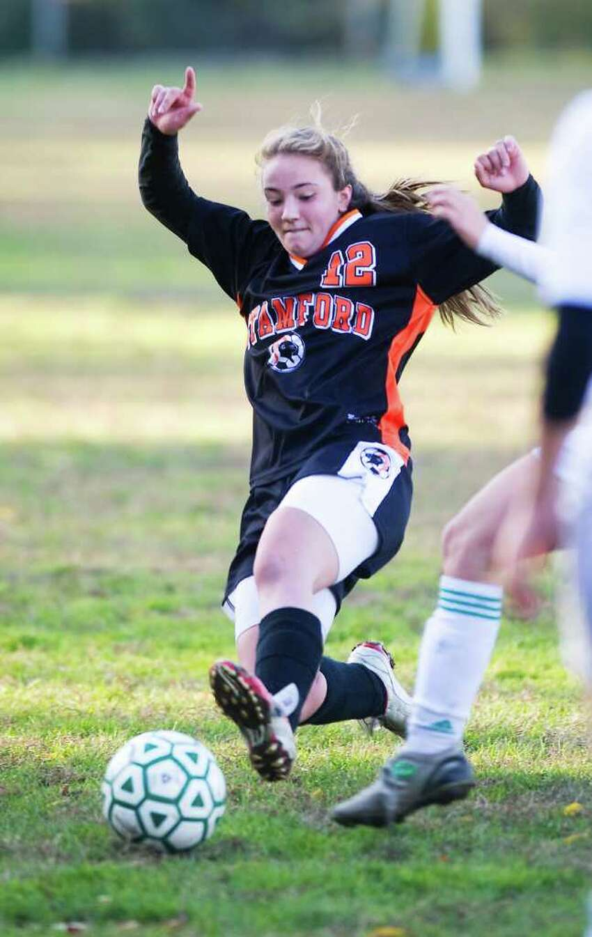 Stamford High School's Angela Altamura reaches for the ball against Trinity Catholic High School in girls soccer at Trinity in Stamford, Conn. on Friday October 22, 2010.
