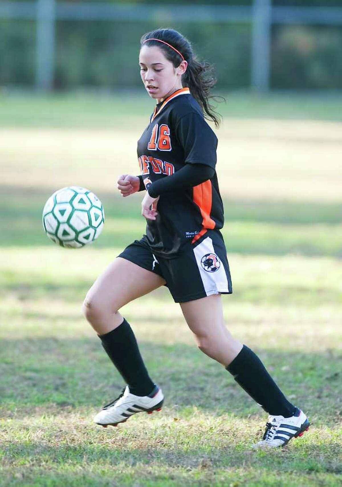 Stamford High School's Sam Lyman controls the ball against Trinity Catholic High School in girls soccer at Trinity in Stamford, Conn. on Friday October 22, 2010.
