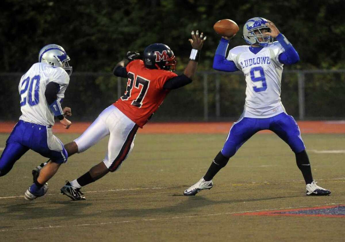McMahon's Jermaine Martin-Riley knocks the ball out of the hands of Ludlowe's Tom Hammons causing a fumble that was recovered by McMahon during Friday's game on October 22, 2010.