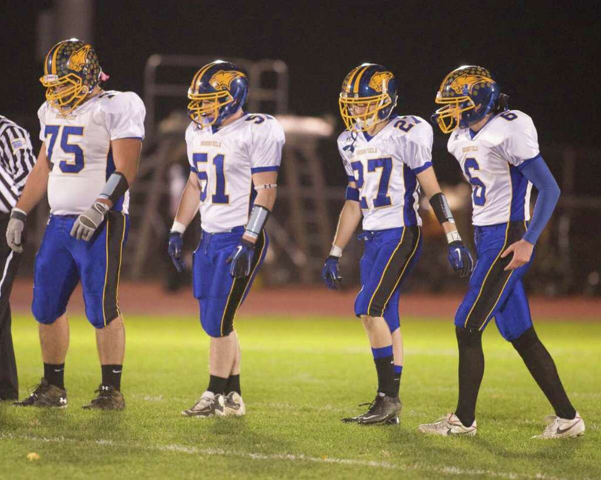 Brookfield captains, left to right, Dion Koumoutseas, Matt Consalvo, Nick Moores and Shea McGorty come out for the coin toss before their SWC football game against New Milford Friday night, Oct. 22, 2010, at New Milford High School.