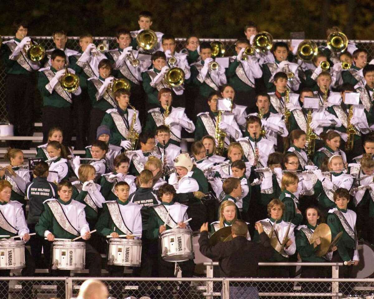 The Green Wave band plays the National Anthem prior to New Milford's football game against Brookfield Friday night, Oct. 23, 2010, at New Milford High School.