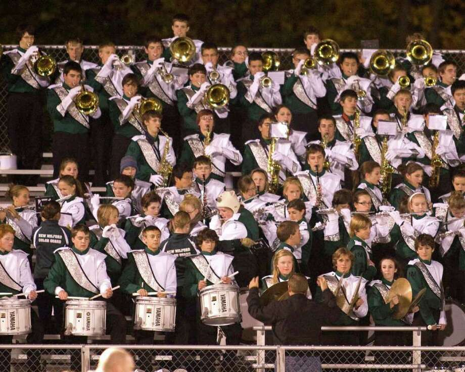 The Green Wave band plays the National Anthem prior to New Milford's football game against Brookfield Friday night, Oct. 23, 2010, at New Milford High School. Photo: Barry Horn / The News-Times Freelance