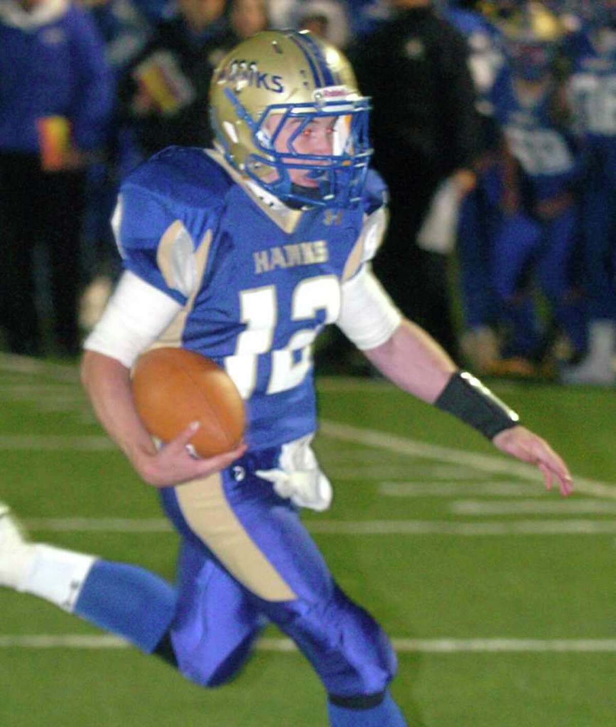 Newtown's 12, Dan Hebert, makes a touchdown during the football game against Bunnell at Southbury Oct, 22, 2010.