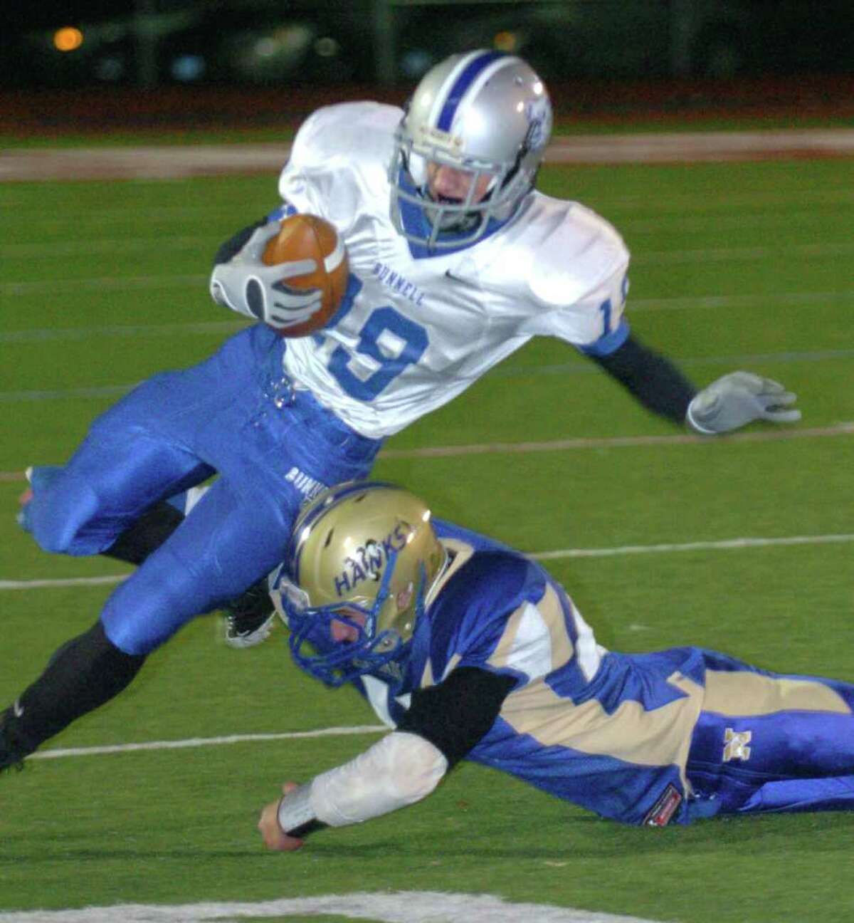 Newtown's 41, Mike Lord tackles Bunnell's 19, Michael Joy, during the football game at Southbury Oct, 22, 2010.