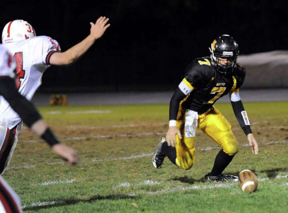 Football highlights between Amity and Fairfield Prep in Woodbridge, Conn. on Friday October 22, 2010. Amity's QB Tyler Vallie fumbles the ball. Photo: Christian Abraham / Connecticut Post