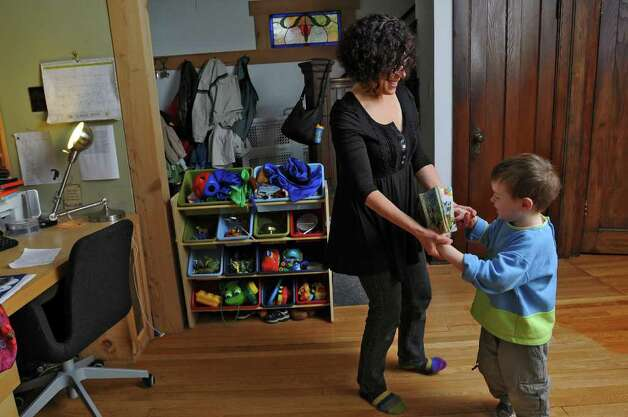 Dance movement therapist Rachelle Smith-Stallman dances with 4 year old Emil Bouget , during a session at his home in Albany, on Tuesday October 19, 2010.  Bouget is autistic. ( Philip Kamrass / Times Union ) Photo: Philip Kamrass