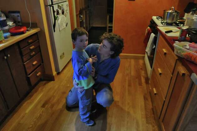 Becky Zimmerman talks to her 4 year old Emil Bouget about getting a snack, near the end of a session with dance movement therapist Rachelle Smith-Stallman,  at his home in Albany, on Tuesday October 19, 2010.  Bouget is autistic. ( Philip Kamrass / Times Union ) Photo: Philip Kamrass