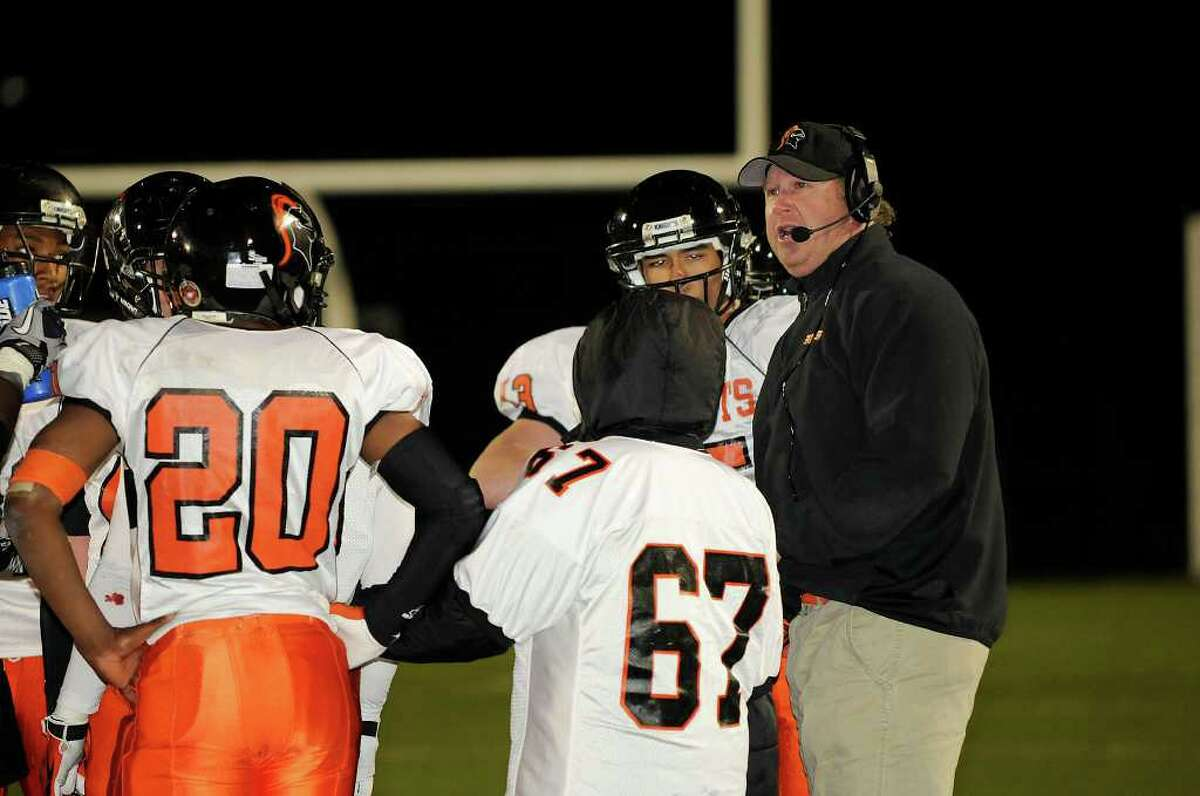 Stamford Coach Brian Hocter talks with his team as Trumbull High School hosts Stamford High School in Trumbull, CT on Friday, October 22, 2010.