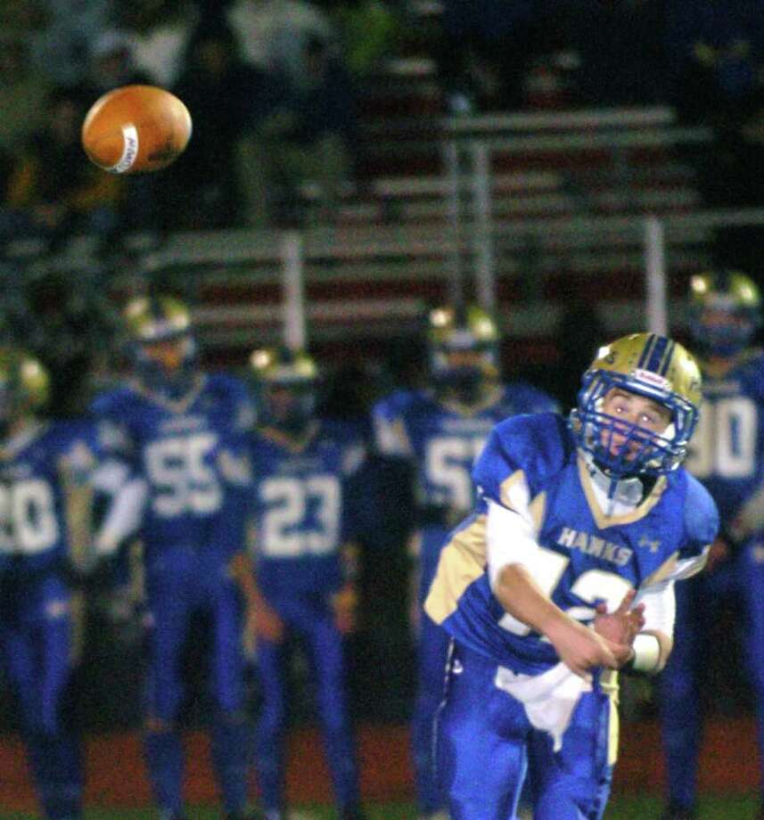 Newtown's 12, Dan Hebert, makes a pass during the football game against Bunnell at Southbury Oct, 22, 2010. Photo: Chris Ware / The News-Times