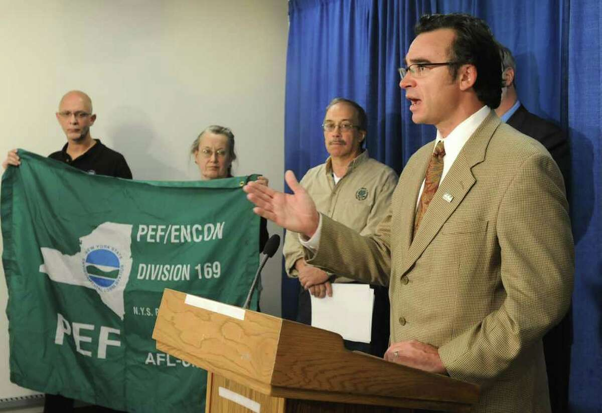 Robert Moore, executive director of Environmental Advocates of New York, speaks Friday during a news conference to oppose the firing of DEC Commissioner Pete Grannis in the LCA room at the Capitol in Albany. (Lori Van Buren / Times Union)