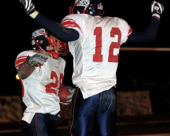 Schenectady's Mister Taylor, left, celebrates his touchdown with teammate Jallah Tarver against Ballston Spa. (Hans Pennink / Special to the Times Union) Photo: Hans Pennink